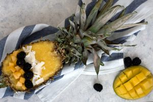 Tropical pina colada smoothie in pineapple